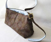 charmed Liebling trapezoidal shoulder bag in brown and blue