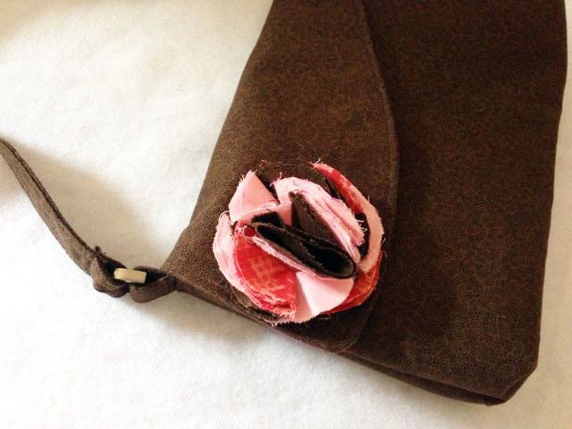 charmed Liebling rose petal bag detail