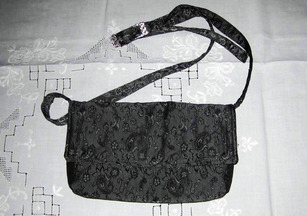 charmed Liebling black evening bag